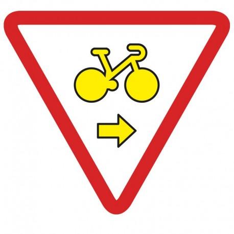 Autorise les vélos à franchir les feux s'ils veulent tourner à droite